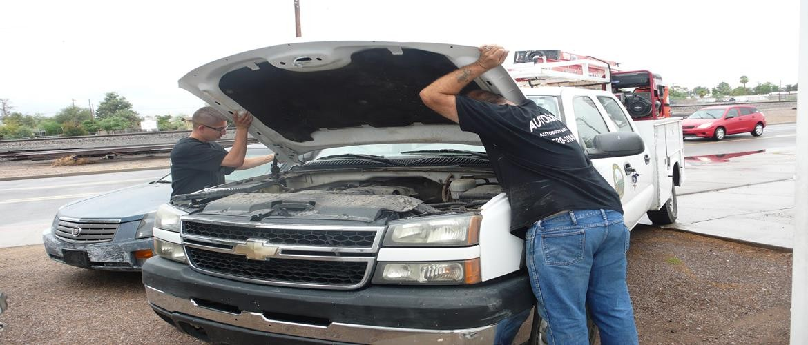 Replacing hood on Chevrolet Truck